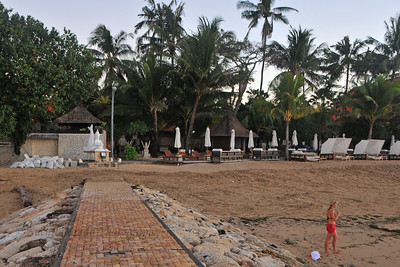 Tourists staying around Sanur beach coming for watching the sunrise as well as taking an early morning dip in the sea-water at Sanur Beach Sanur (Indonesian: Pantai Sanur Pronounced: Sah-Noor) is a coastal stretch of beach of Denpasar city located in South East of Bali. Its about a 30 minutes drive from Ngurah Rai International Airport. Those wanting to avoid the mad-crowds of Kuta prefer Sanur beach which has grown into a little town in its own right. It contains a number of resorts and is a popular tourist destination. lessed with reef bed aquatics and various kinds of marine organism, Sanur is the second best diving spot in Bali after Tulamben. Its moderate wind and transparent water surely provides water sport enthusiasts with a playground of the first degree in terms of quality and safety. It also has a wide variety of restaurants, cafes, shops and nightlife.