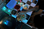 Getting vegetarian food is quite difficult in Bali. Although Hindus, hardly anyone is vegetarian. Near Sukawati, with the help of a customer, we guided a street corner food stall to make us  ...