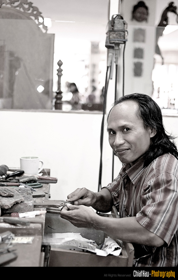 He is actually a gold smith in one of the shop. Thanks to him for posing for me. :)