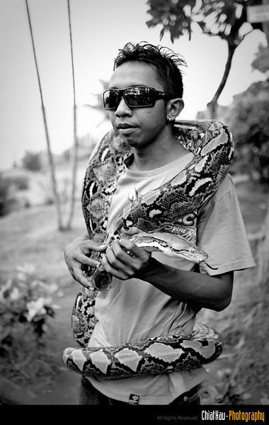 As well as this snake keeper? who will allow the tourist to take a photo with the snake for some small fees. :)