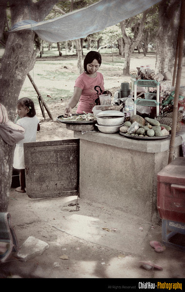 I noticed this fruit seller and I decided to take a shot here... and then...