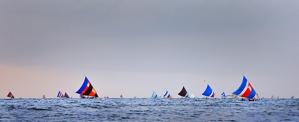 Balinese colorful sails of fishermen coming home