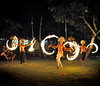 Fire+dancers+twirling-734614039-O