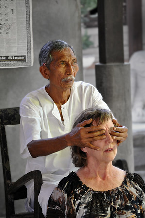Healer+diagnosing+patient-734638158-O