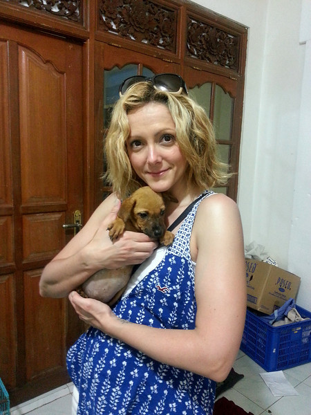 Amanda holding a puppy at BARC Dog Recue