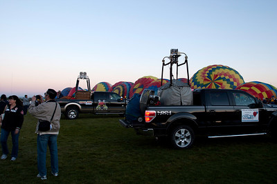 Chase trucks in front of Rainbow Riders balloons
