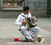 Street Performance. The dog was guarding the day's receipts. His water dish was behind the accordian player.