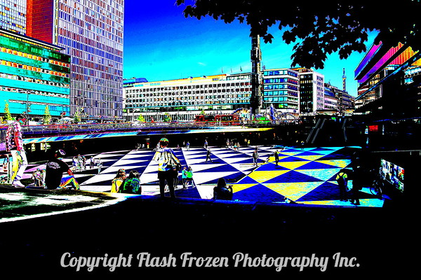 Artistic view of the Train Station and a square with offices and shops..people just hanging out on a beautiful sunny day in Stockholm!