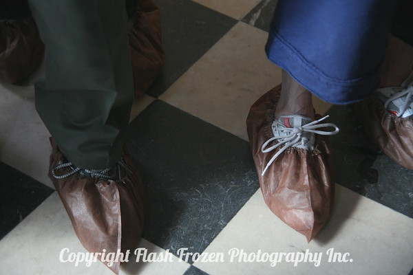 Protective shoe coverings. We wore them in a few of the venues.