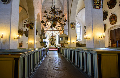 In the Cathedral of St Mary the Virgin  The pews are in  the style other cold climates - with high walls and doors.