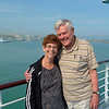1st Port:  DOVER, ENGLAND.  Onboard our ship, the Insignia, Ann and Court pose in front of the famous White Cliffs Of Dover.