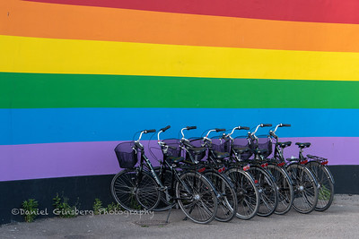 Bicycles against rainbow wall in Copenhagen, Denmark.