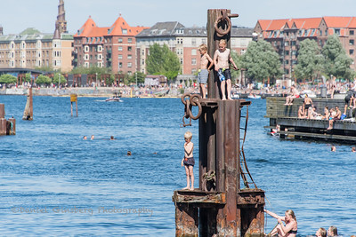 Boys on pier in Copenhagen, Denmark.