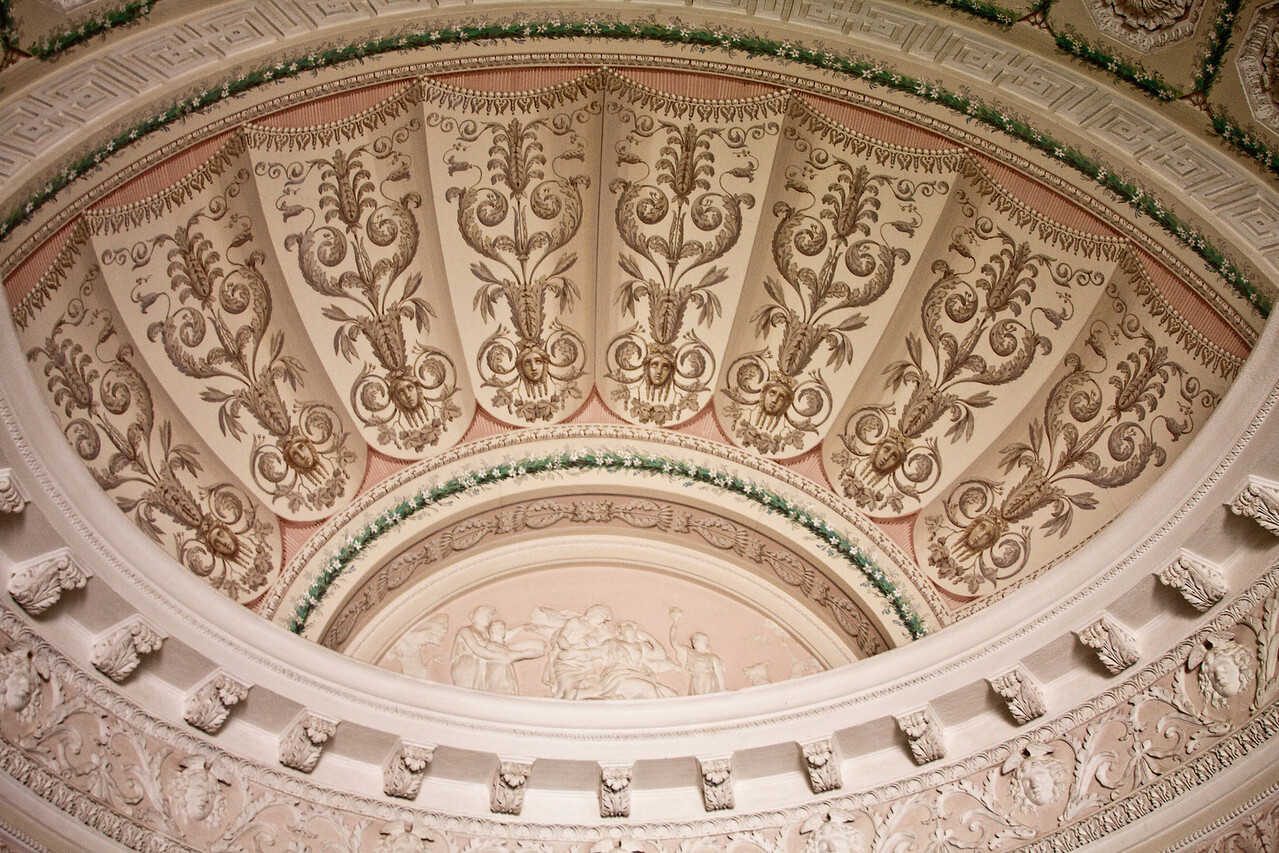 Detailed view of arched ceiling decoration.