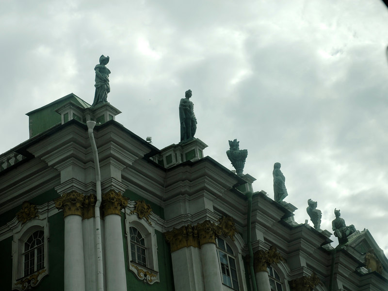 105 St Pete statues on building