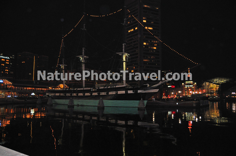 "USS Constellation in Inner Harbor, Baltimore - Night photo. Commissioned in 1855, the U.S.S. Constellation was the last all-sail ship built by the United States Navy. Today the historic vessel lies ""at anchor"" (nautical term - actually the Constellation is tied up to a pier) in Baltimore's Inner Harbor, where visitors can climb aboard and get a firsthand look at what the sailors life was like in days past."