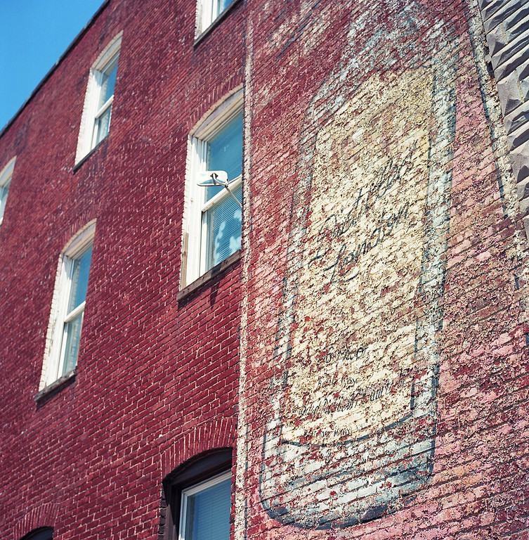 Vintage painted brick advertisement in Federal Hill Baltimore