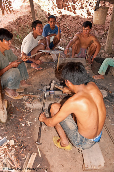Khmu Men Working and Socializing In Ban Sopsim, Laos