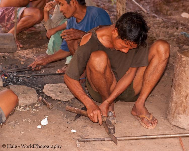 Khmu Man Cutting A Steel Rod in Ban Sopsim, Laos
