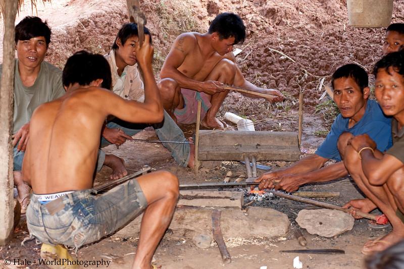 Khmu Men Making Knives Underneath A House
