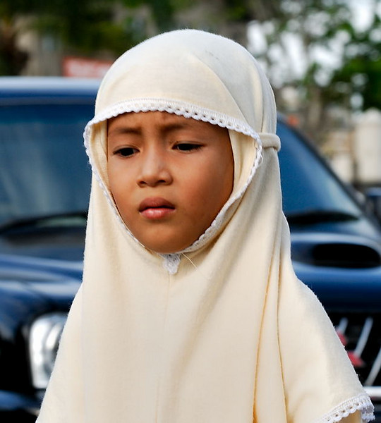 A young Acehnese girl on her way to afternoon prayers.