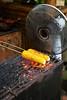 Roasting corn on the cob at Kampung Daun restaurant.<br /> IMG_0225