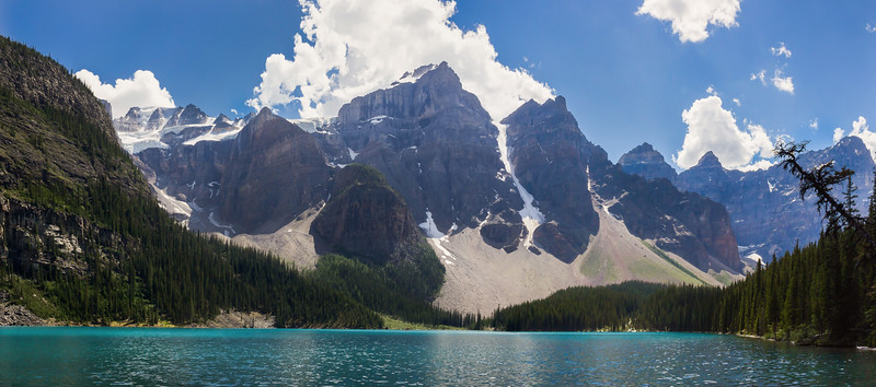 Panorama of Moraine Lake at midday. Mountain faces are in shadow most of the day.