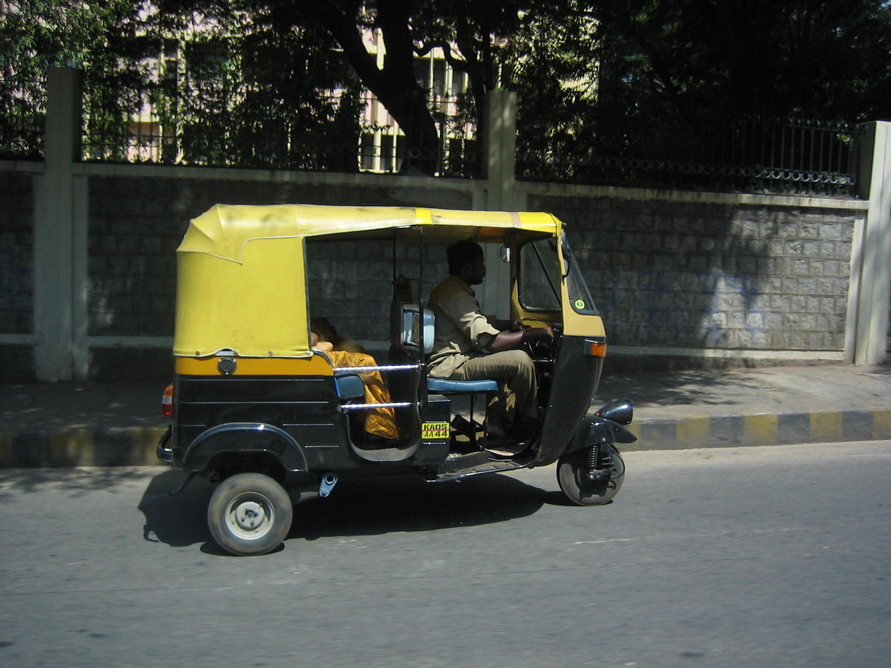 Motorized rickshaw. They don't really fit three people in the back very well.