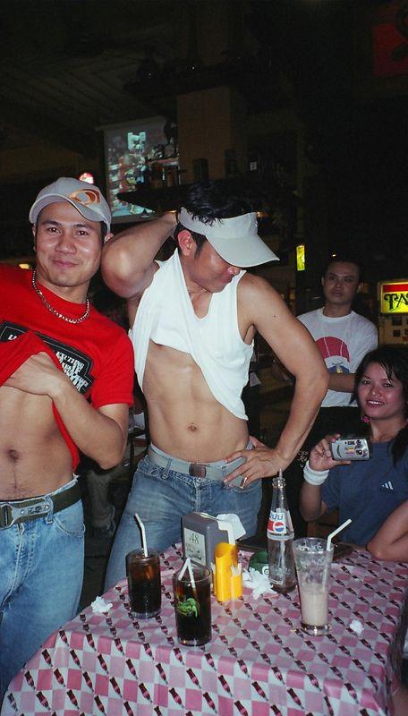 2 Thai's showing off their tummies