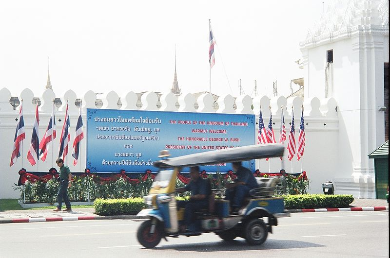 Sign welcoming President Bush (and Tuk Tuk) outside Palace