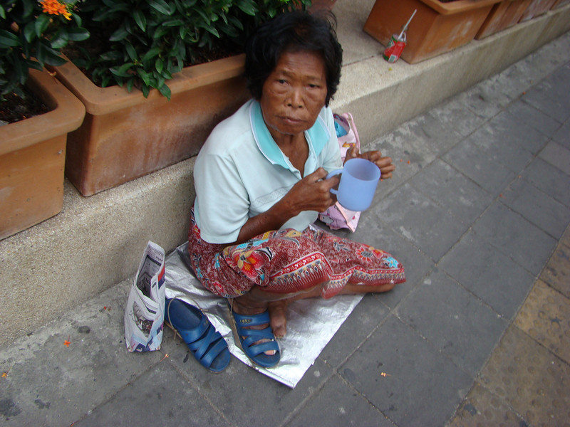 leper begging on streets of bangkok
