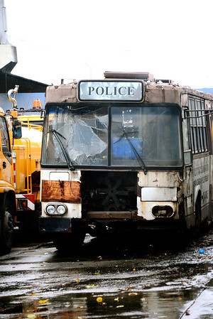 A burnt out police bus, Bangkok
