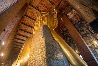 Wat Pho (Thai: วัดโพธิ์). Temple of the Reclining Buddha, its official name is Wat Phra Chetuphon Vimolmangklararm Rajwaramahavihar.  Wat Pho, is a contraction of its older name Wat Photaram. The temple is first on the list of six temples in Thailand classed as the highest grade of the first-class royal temples. It is associated with King Rama I who rebuilt the temple complex on an earlier temple site, and became his main temple where some of his ashes are enshrined. The temple was later expanded and extensively renovated by Rama III. The temple complex houses the largest collection of Buddha images in Thailand, including a 46 m long reclining Buddha. The temple is considered the earliest centre for public education in Thailand, and the marble illustrations and inscriptions placed in the temple for public instructions has been recognised by UNESCO.