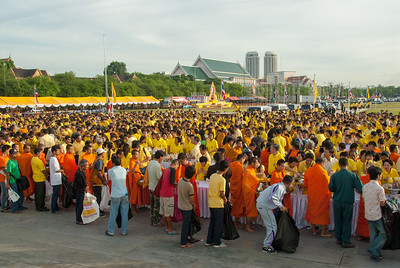 Monks line up to receiving alms from royalty and public in general at the celebrations in Bangkok, Thailand.