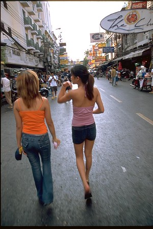 Two girls on Khao San Road Bangkok, Thailand