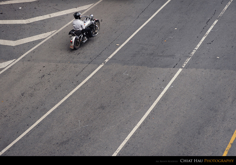 A lone rider on the street