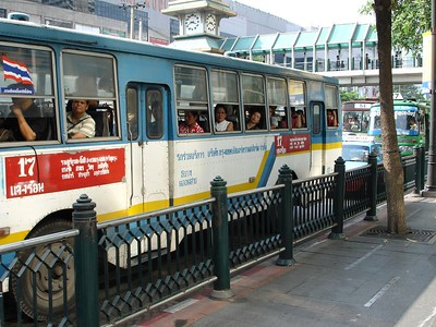 The skytrain costs about from 25 cents to 50 cents but that is too expensive so most people take the slow busses that have no airconditiong