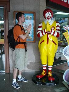 Ronald McDonald teaches me how to do the traditional Thai greeting, the wai