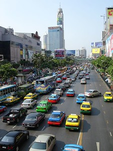 The streets are colorful with cabs and billboards