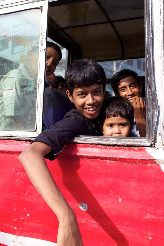 Happy kids in a bus.