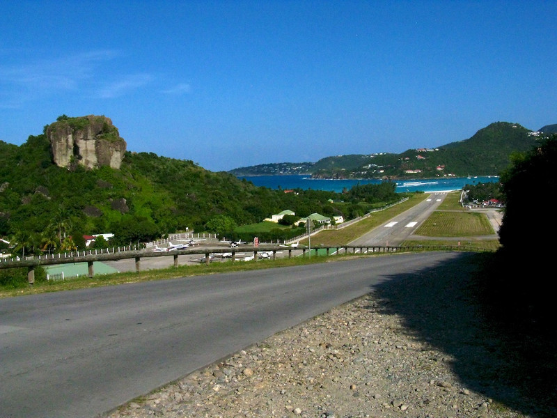 St. Barth's has the craziest airport I have ever seen. Planes come in skimming the ridge (just off camera to my left), do a death swoop to the runway, then pull out and hit the brakes. If they go too far, they're in the water. 600 meters. Insane.