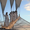 The deck crew climbs onto the bowsprit of the Royal Clipper