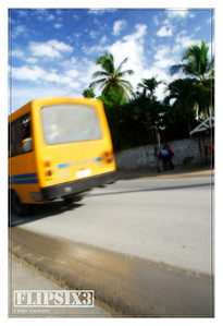 A flash of yellow, and a blast of music - the Barbados 'boogie bus'.