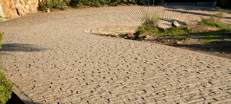 A cobblestone path leading to the residence