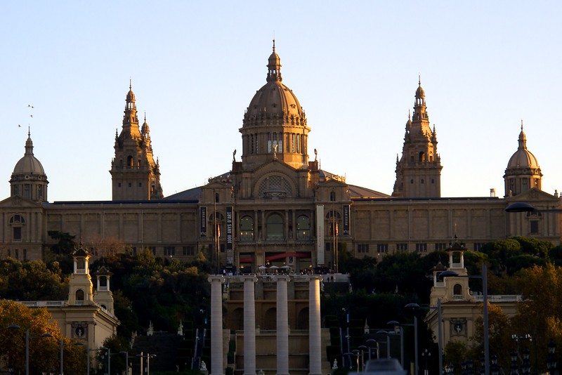 The Palau Nacional at sunset. It is an imposing building that was erected for the 1929 International Exhibition, which was held on the flank of a mountain called Montjuïc. The sprawling structure now houses the National Art Museum of Catalonia.