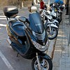 Motor bikes, a common sight - here outside the wall surrounding Parc Guell