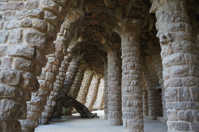 Visitors can walk down among the columns that decorate the trails running through Parc Guell.