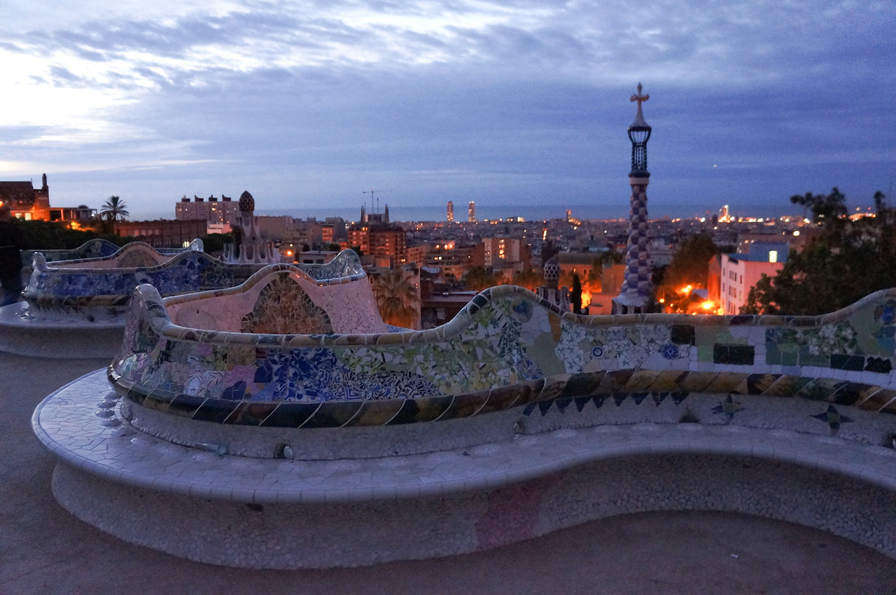 There is an immense open terrace at the front of Parc Guell rimmed by a serpentine railing and benches. It offers a stunning view of Barcelona and the ocean beyond.
