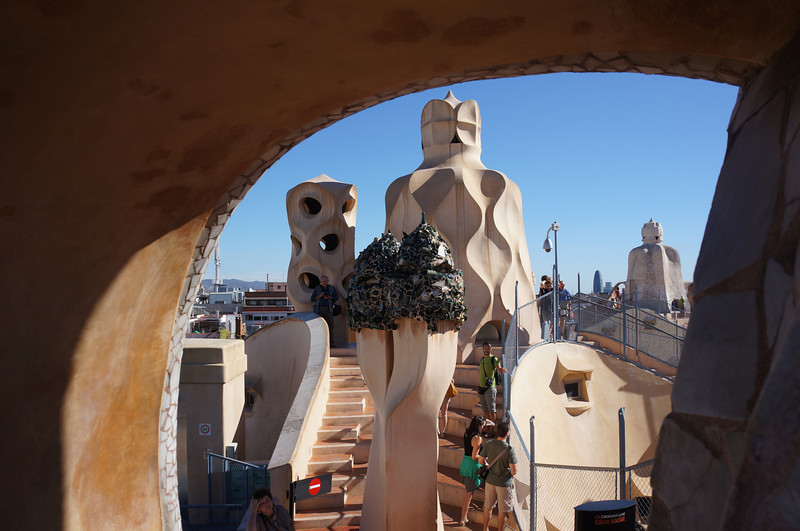 On the roof of Casa Mila (aka La Pedrera). Not only did Gaudi create a magical rooftop by sculpting around the chimney stacks, but he created huge arched passageways to frame his work.
