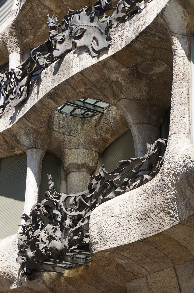 A close up view of a balcony on the outside of Casa Mila (aka La Pedrera). Gaudi's design of every aspect of this apartment/office complex with both magical and mysterious qualities.